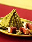 Saffron-flavored broad bean mash ,grisons meat and halloumi rolls