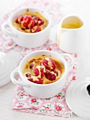 Small casserole dishes of raspberry and ginger sabyon