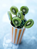 Kiwi lollipops with Halloween vermicellis