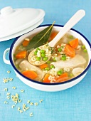 Chicken broth with vegetables and alphabet pasta