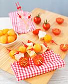 Melon,cherry tomato and chicken brochettes