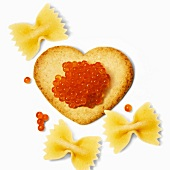 Heart-shaped biscuit with fish roe and farfalle