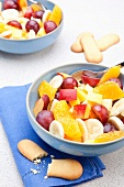 Apple,peach,orange,grape and banana fruit salad