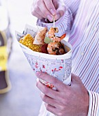 Seafood and sweetcorn in a paper cone