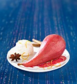 Pear poached in spicy red wine with ice cream
