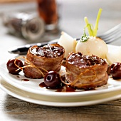 Doe Tournedos wrapped in bacon with cherries