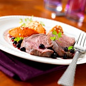 Saddle of venison with blackcurrants,carrot puree quenelles