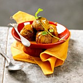 Meatballs in coconut and curry sauce
