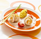 Rolled sole fillets coated in crushed peanuts, citronella emulsion and rice with seafood