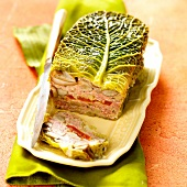 Rabbit and vegetable terrine wrapped in cabbage leaves