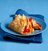 Stuffed omelette with red and yellow peppers