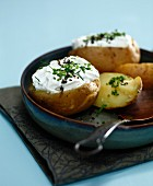 Oven-baked potatoes with fromage blanc and herbs
