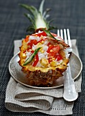 Exotic rice salad served in half a pineapple