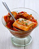 Herring in sweet and sour tomato sauce