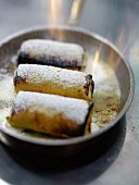 Flambéed crepes rolls with Alsatian cherry water