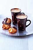 Cups of expresso coffee and coconut and chocolate Rochers
