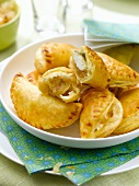 Small goat's cheese and stewed onion turnovers