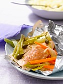 Trout with capers and vegetables cooked in aluminium foil