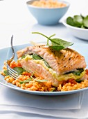 Roasted salmon stuffed with spinach, orange lentils cooked with coconut milk