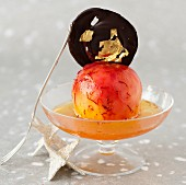 Pear poached in Sauternes,vanilla and saffron,chocolate Palet decorated with gold