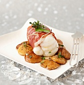 Roasted monkfish wrapped in bacon,pan-fried ceps