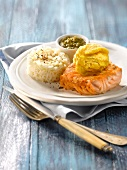 Piece of grilled salmon with mango sorbet and rice