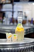 Jug and glasses of lemon and lime juice