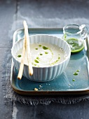 Cream of artichoke soup with herb puree