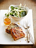 Asian-style caramelized salmon with sesame seeds, spinach-soya salad