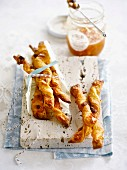 Flaky pastry twists with orange marmelade