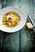 Turkey raviolis and vegetable broth