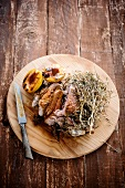 Turkey thigh with hay and roasted plums