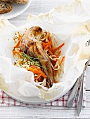 Rabbit's thigh, carrots and cabbage cooked in wax paper