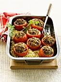 Baked tomatoes stuffed with plain wheat and mushrooms
