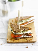 Cream cheese,sprouts and sun-dried tomato rye bread sandwiches