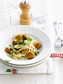 Pasta in creamy sauce with breaded turkey meatballs