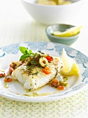 Cod with green olives and tomatoes