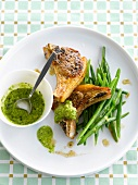 Grilled lamb chops with rocket lettuce pesto and green beans