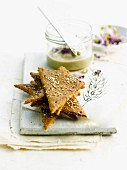Buckweat crackers topped with sesame seeds and poppyseeds