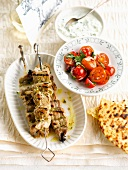 Grilled veal brochettes and cherry tomato salad