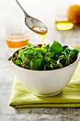 Corn lettuce and watercress salad with honey and orange zest vinaigrette