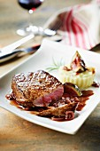 Thick beef steak with fig and kirsch sauce