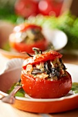 Tomato stuffed with Comtois Petit gris snails