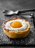 Fried egg-shaped coconut mousse and mango tartlet