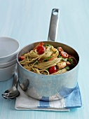 Saucepan of spaghettis with shrimps and cherry tomatoes