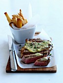 Piece of grilled beef with butter and french fries