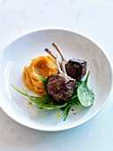 Lamb chops with pumpkin mash and baby spinach leaves
