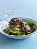 Beef patties with fennel,green apple and spinach salad