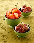 Fruit and ham bites on sticks