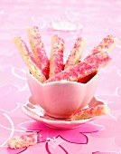 Hazelnut shortbread sticks coated in pink sugar